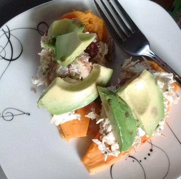 Twist on breakfast: Whole30 chicken salad and avocado on top of toasted sweet potato slices.